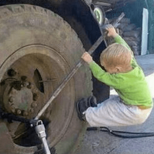 Small boy trying to take off a big tire - Disruptive Advertising