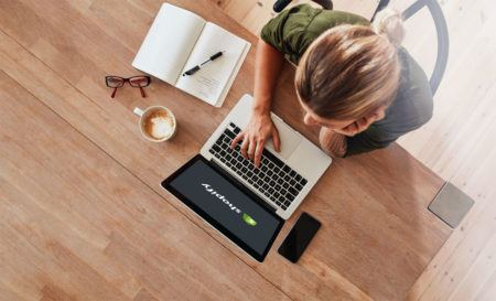 Woman with Laptop showing Shopify Logo